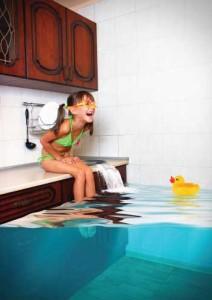 Girl sitting on overflowing sink